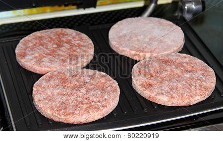 Frozen Hamburgers On The Grill