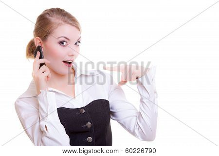 Surprised Businesswoman Pointing Phone. Business Communication.