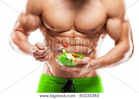 Shaped And Healthy Man Holding A Fresh Salad Bowl
