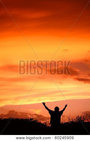Man holding arms up in praise