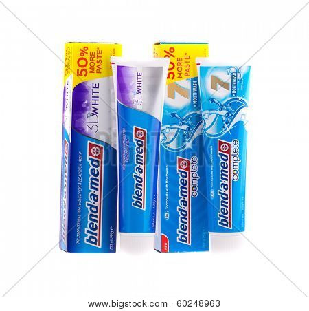 KRAKOW, POLAND - FEB 21, 2014: Studio shot packs toothpastes of Blend-A-Med. Blend-A-Med (Crest) is a brand of toothpaste made by Procter & Gamble sold worldwide, since 1987.