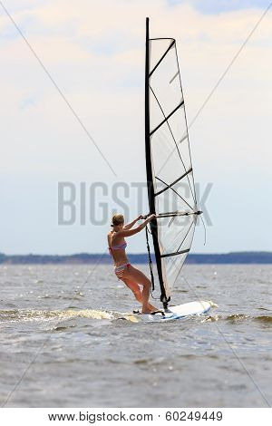 Rear View Of Woman Windsurfing