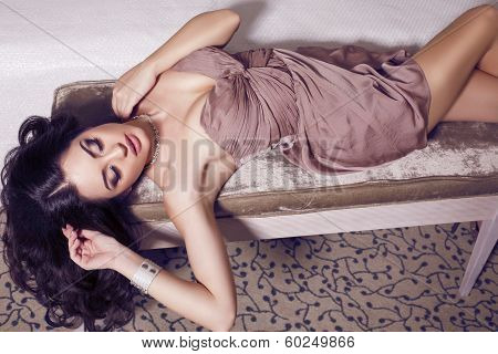 beautiful sexy brunette lying on sofa