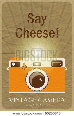 Retro photographic poster with the slogan Say Cheese!, on crumpled brown paper background.