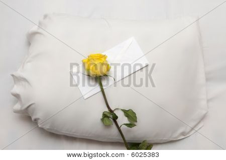 Yellow rose and letter