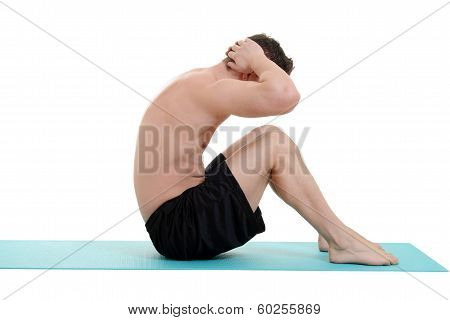young man doing situps on blue mat