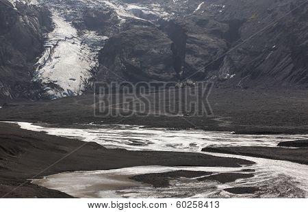 Iceland. South Area. Eyjafjalajokul Glaciar Tongue, River And 4Wd Vehicle.