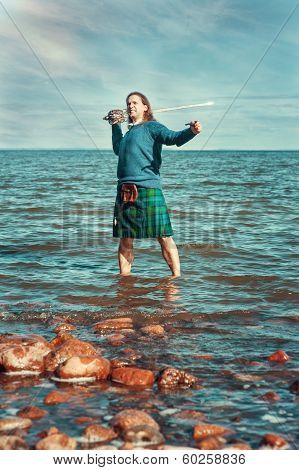Brave Man With Sword In Scottish Costume