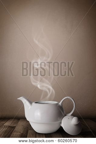 Tea pot with abstract white steam, close up
