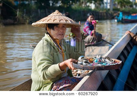Floating Vendors On Long Wooden Boat
