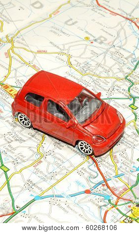 Small Toy Car On Road Map