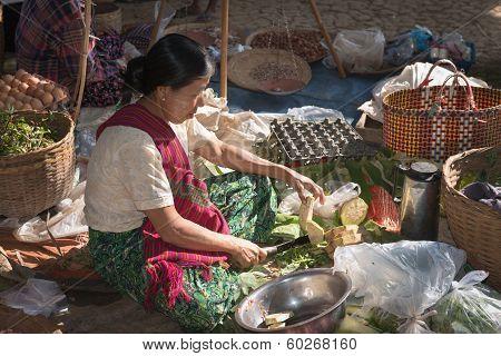Burmese Woman Cut Vegetables On Asian Open Market