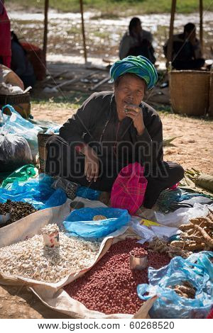 Burmese Woman Smoke Cheroot Cigar And Sell On An Open Market