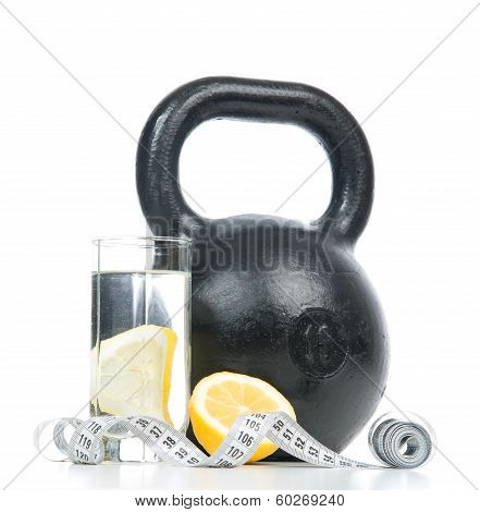 Big Black Fitness Weight With Tape Measure And Glass Of Drinking Water
