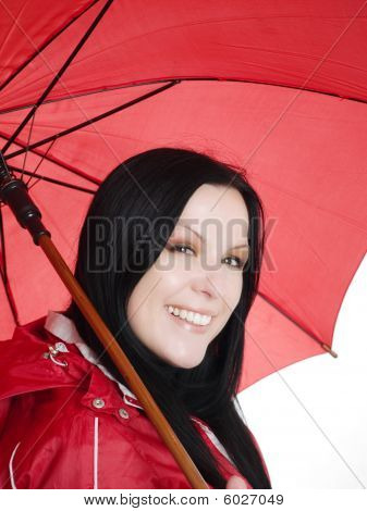 Smiling Brunette Woman In Fall, Rainproof Clothes Holding Umbrella