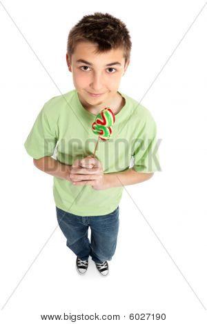 Boy Holding A Lollipop