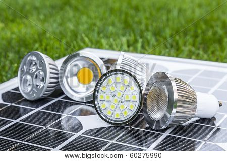 Various Gu10 Led Bulbs On Photovoltaics In The Grass