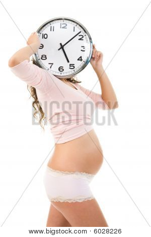 Pregnant Female With Clock