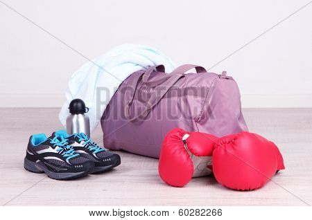 Sports bag with sports equipment in gymnasium