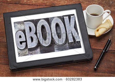 ebook (electronic book) - a word in grunge letterpress metal type on a  digital tablet with a cup of coffee