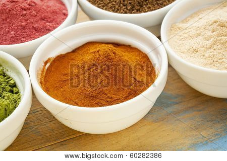 raw organic dried mangosteen fruit powder in a small ceramic bowl