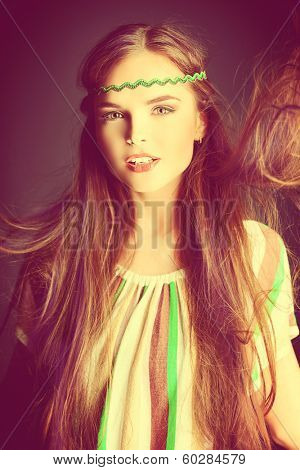 Beautiful girl with natural make-up and long hair in motion. Hippie style.