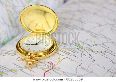 old clock and geographical map