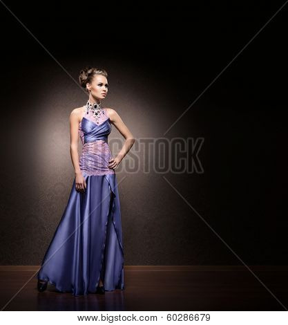 Beautiful woman in glamour dress. There is copy space.