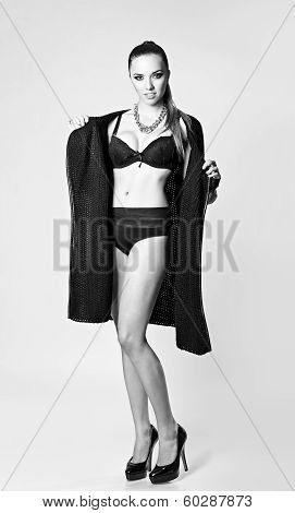 Studio Fashion Shot: A Sexy Young Girl Wearing Black Sweater