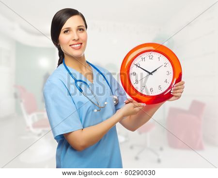 Doctor with clock at medical office