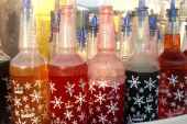 image of ice-cream truck  - Colorful bottles with different flavoring  for icy snow cones - JPG