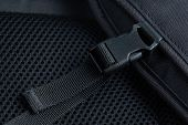 picture of sling bag  - Black plastic buckle with strap on backpack - JPG
