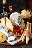 image of cheese platter  - Catering cheese platter with ham grissini and fresh pomegranate and apple - JPG