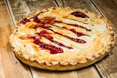 picture of cherry pie  - Homemade Organic cherry Pie on wooden table - JPG