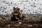stock photo of landfills  - Shot of bulldozers working a landfill site - JPG
