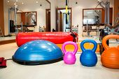 foto of heavy bag  - Kettlebells at fitness gym with stepper - JPG