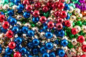 foto of carnivale  - Colorful Mardi Gras beads isolated on white - JPG