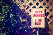 a no swimming comic sign done with a vintage retro instagram filter