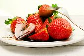 stock photo of vinegar  - strawberries with balsamic vinegar over ceramic plate - JPG