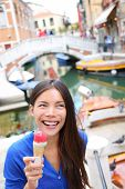 stock photo of gelato  - Ice cream eating woman in Venice - JPG