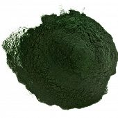 stock photo of algae  - Spirulina powder  algae nutritional supplement heap surface close up top view - JPG