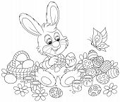foto of cony  - Rabbit coloring Easter eggs to the holiday - JPG