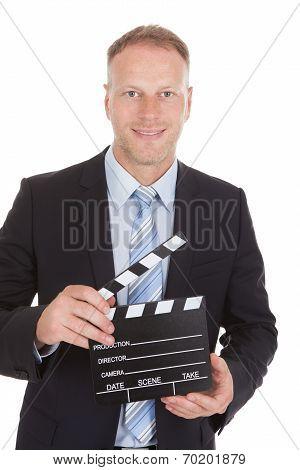 Businessman Holding Clapperboard