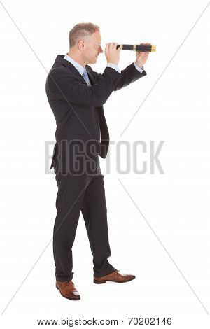 Businessman Looking Through Handheld Telescope