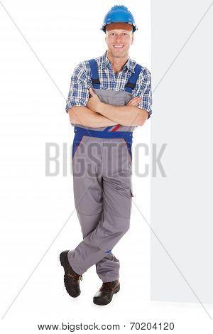 Manual Worker Standing Arms Crossed