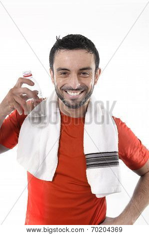 Happy Sport Man Posing Corporate With Water And Towel For Fitness Center
