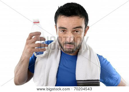 Athletic Sport Man  Holding Water Bottle Wiping Out Sweat After Training