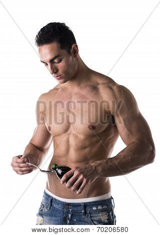 Strong Muscular Man Taking Medication