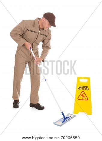 Male Servant Mopping Floor Over White Background