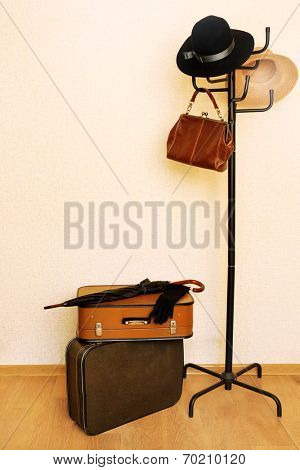 Vintage old travel suitcases on floor in vestibule